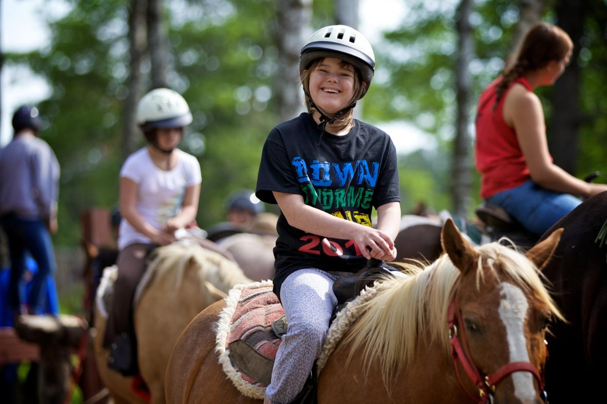 Camper horseback riding.