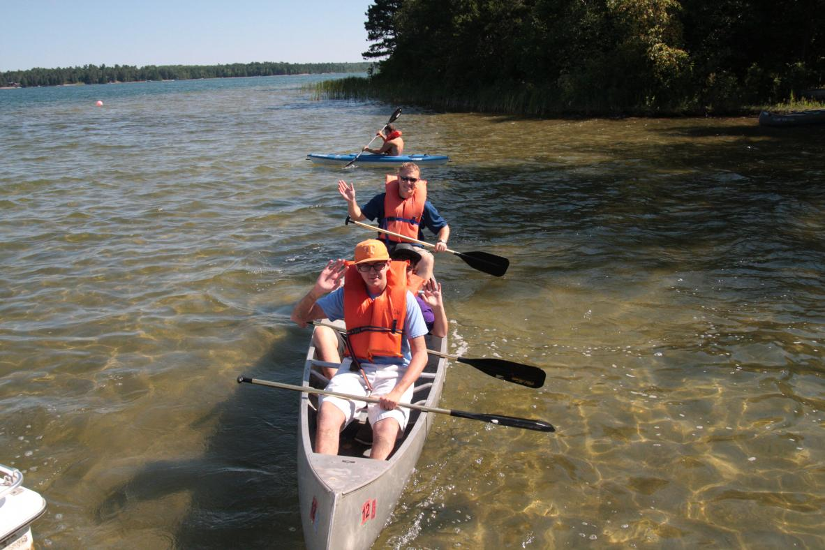Campers canoeing in the lake.