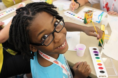 girl painting at camp