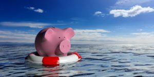 Piggy bank on a life raft