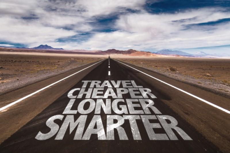 Highway with the words Travel Cheaper, Longer Smarter painted on it