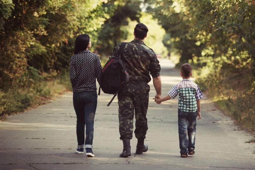 Dad walking with daughter and son