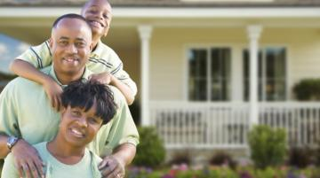 African-American family in front of house