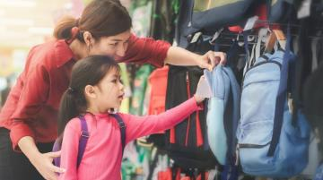 Mom and daughter shopping for backpacks