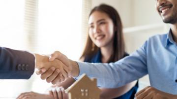 Men shaking hands after finalizing home purchase