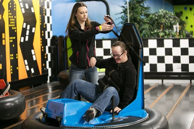 Photo of a person with disabilities having fun in the community.