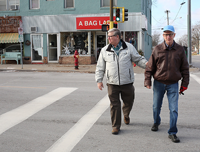 Men walking across street.