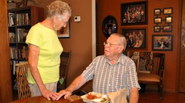 Older adult receiving a home delivered meal.
