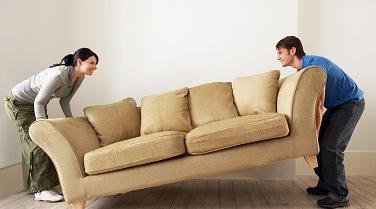 Couple moving couch.